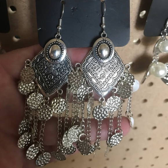 Indian style earrings w/multiple hammered discs.
